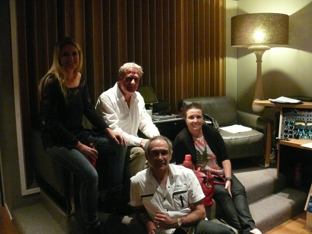 Photo of Rikelle Brown, Steve Brown, Sheridan Gaudry and Milko Foucault-Larché in the control room at A Sharp Studio